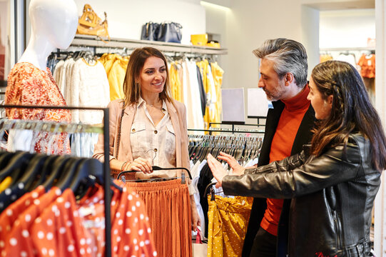 Three friends shopping in a boutique
