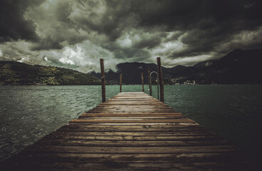 Wall Mural - Lake Iseo Stormy Weather and the Wooden Pier