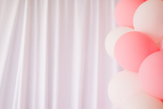 white curtain with colorful balloons, background for a greeting card