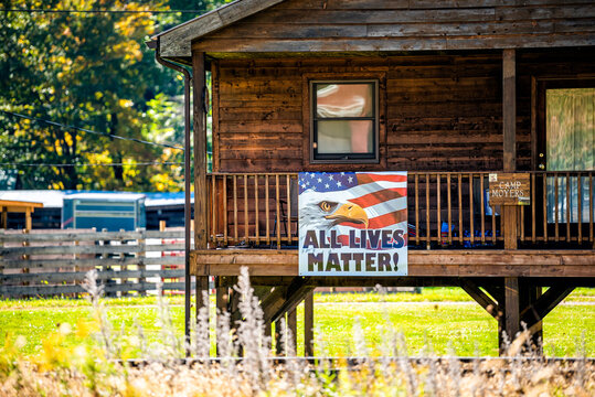 Bartow, USA - October 6, 2020: Town in West Virginia countryside and sign on house building cabin for All lives matter in Durbin Frank area