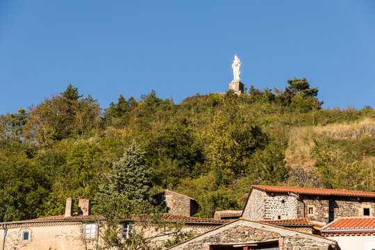 Usson, France. The Vierge Monumentale (Monumental Virgin), a large statue of the Virgin Mary overlooking the village of Usson