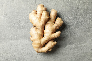 Fresh raw ginger on gray background, space for text