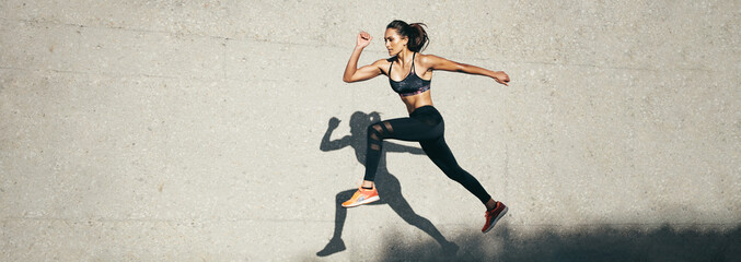 Fit woman jumping and running