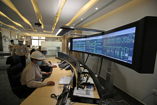Employees are seen at the pipeline control room of the Saline Water Conversion Corporation Ras Al-Khair Power and Desalination Plant in Ras al Khair,