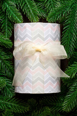 Wall Mural - Top view of festive gift box decorated with green fir tree branches. Christmas time with copy space