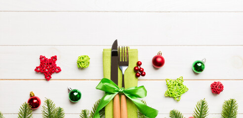 Wall Mural - Top view of festive cutlery on new year wooden background. Banner Christmas decorations with empty space for your design. Holiday dinner concept