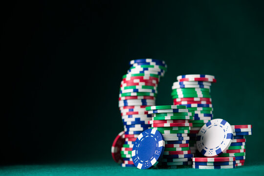 Stack chips poker on a table background