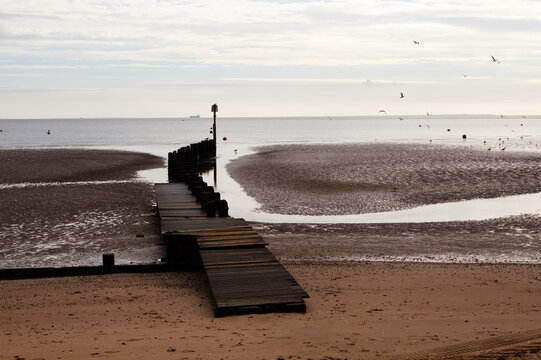 A wooden jetty leading out into the water.
