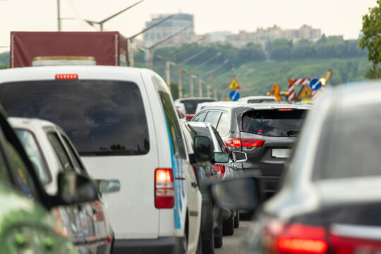 Highway interstate road with car traffic jam and Kiev on background. Motorway bumber barrier gridlock due country border control point. Vehicle crash accident and queue bottleneck on freeway