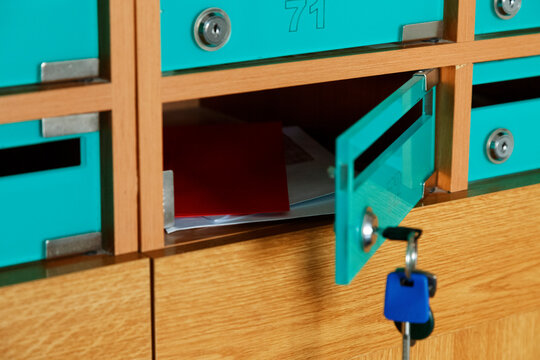 Letters and envelops in open postbox in post
