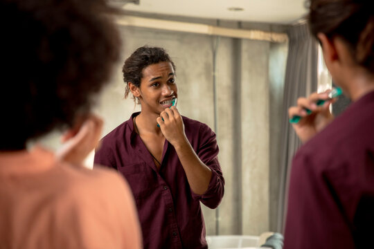 Couple brushing teeth together