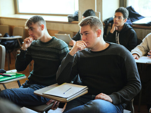 Students at class concentrated with the lecture