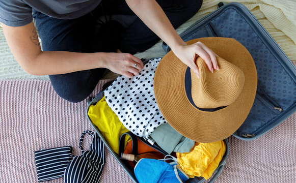 Unrecognizable lady going on summer trip