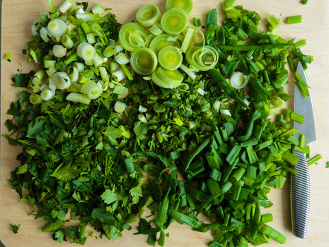 Various chopped herbs on cutting board