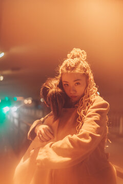 portrait of young asian woman on the street at night