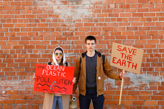 Young couple protesting against environmental changes