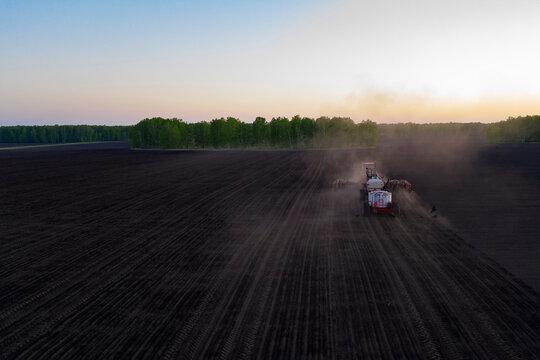 Tractor working in plowed field