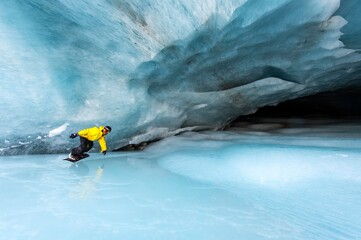 Snowboarding in the ice cave, Val Roseg, Pontresina, Canton of Graubuenden, Switzerland, Europe