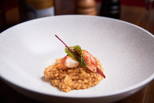 Risotto with lobster dish in a high cuisine restaurant