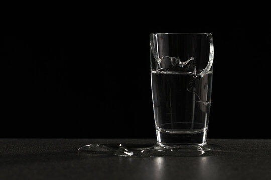 broken glass of water from which water flows out