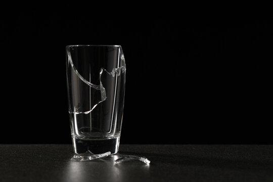 broken empty glass on a ceramic surface on a dark background