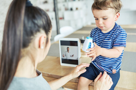 Mother and child in online consultation with pediatrician