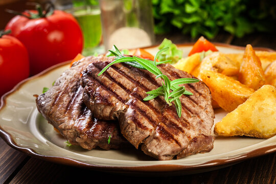 Succulent portions of grilled fillet mignon served with baked potatoes