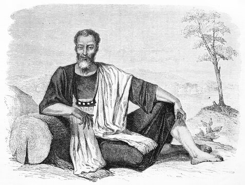 portrait of a Marabout from Adrar region, Africa, posing outdoor crouched ethnic dressed. Ancient grey tone etching style art by Bertall, Le Tour du Monde, Paris, 1861