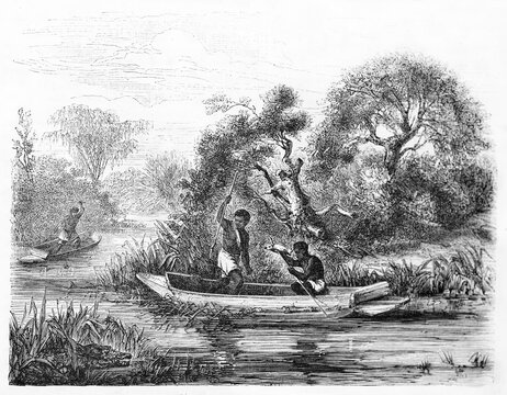 african fishermen spear fishing from canoe on Fal�m� river (on the border between Senegal and Mali). Ancient grey tone etching style art by Duvaux, Le Tour du Monde, Paris, 1861