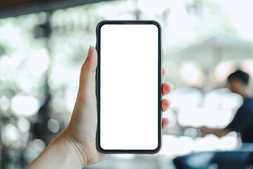 Women's hands holding cell telephone blank copy space screen. smartphone with blank white screen...
