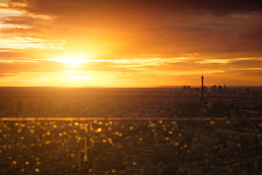 Epic sunset above Paris, the headquarter of La Défense and the iconic Eiffel Tower