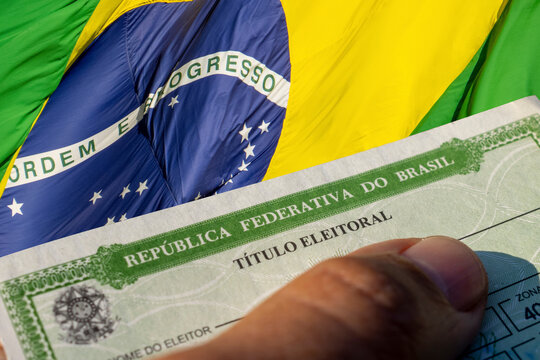 detail of the title of Brazilian voter and flag of Brazil. 2020 elections in Brazil(Título de eleitor ou título eleitoral).