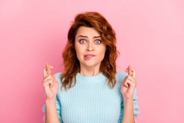 Fototapeta Close-up portrait of her she nice attractive lovely pretty cute scared wavy-haired girl worrying biting lip showing crossed fingers isolated over pink pastel color background obraz