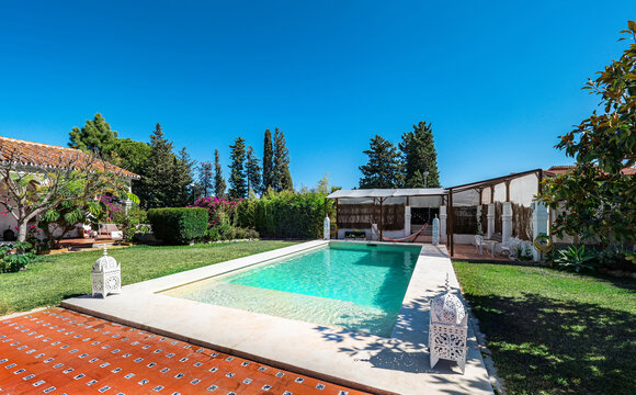 Holiday villa with a swimming pool with tanning ledge, grass,garden, porch and gazebo.