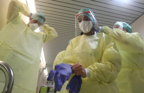Doctors work as patients suffering from coronavirus disease (COVID-19) are treated at Saint-Jean Clinic in Brussels