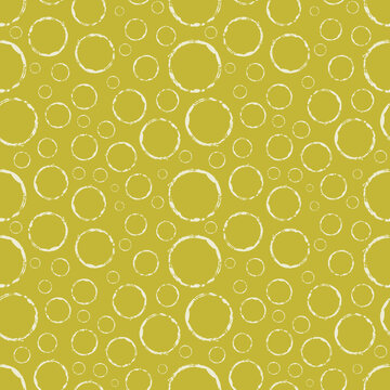 Seamless pattern coffee cup rings on mustard yellow background