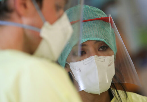 Doctors work as patients suffering from the coronavirus disease (COVID-19) are treated at Saint-Jean Clinic in Brussels