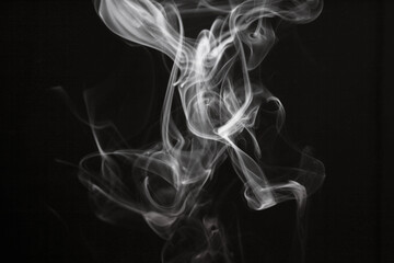White smoke blot on black background