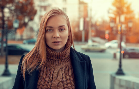 Portrait of a young woman on an autumn background