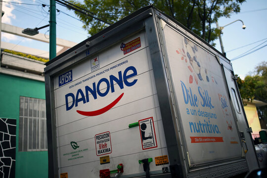 A company logo of the French food group Danone is pictured on a truck in Mexico City