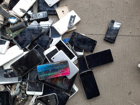 Bangkok, Thailand - October 11, 2020 Many old mobile phones are broken or not working or out of date. E-waste heap is an environmental problem, waste management concept.