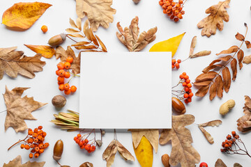 Beautiful autumn composition with empty card on white background
