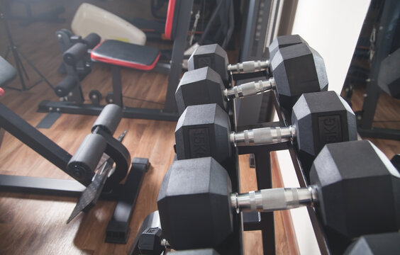 Metal dumbbells for strength training in gym.