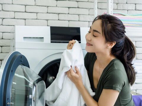 Asian woman in laundry room.