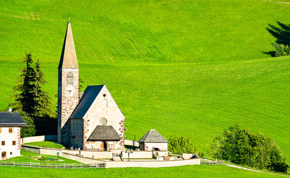 The Chruch of Santa Maddalena in the Dolomites Mountains. UNESCO world heritage in South Tyrol, Italy