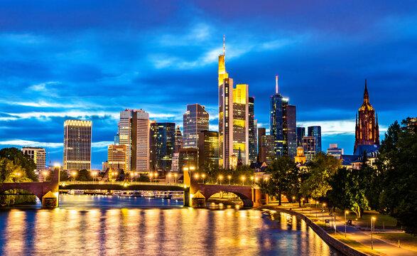 NIght skyline of Frankfurt above the Main river in Germany