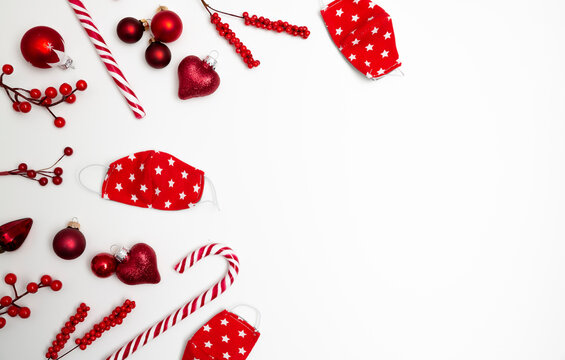 Christmas background banner with red face masks, candy cane and christmas ornaments on white background
