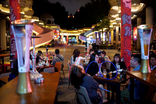 People drink beer at a bar as the coronavirus disease (COVID-19) outbreak continues in Shanghai