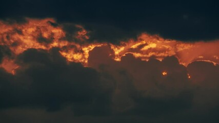 Fotobehang - Epic dramatic sunset sky framed in dark storm clouds. Timelapse, 4K UHD.
