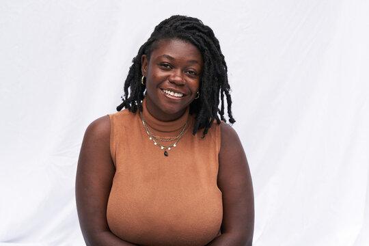 Portrait smiling plus size Black woman with locs